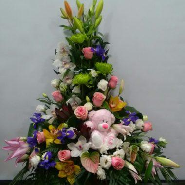 Flores para nacimiento con peluche